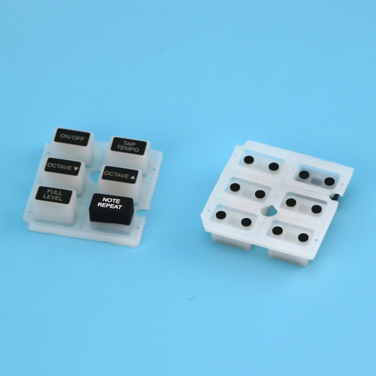 Silicone keypads with backlit effect, with carbon pills